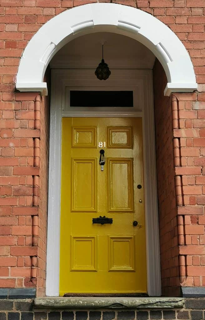 Bright Ocre painted door on classic Edwardian house
